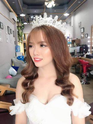 Top 7 kiểu tóc đẹp cho cô dâu mặc áo dài cưới (1)
