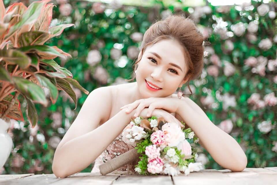 Top 7 kiểu tóc đẹp cho cô dâu mặc áo dài cưới (2)